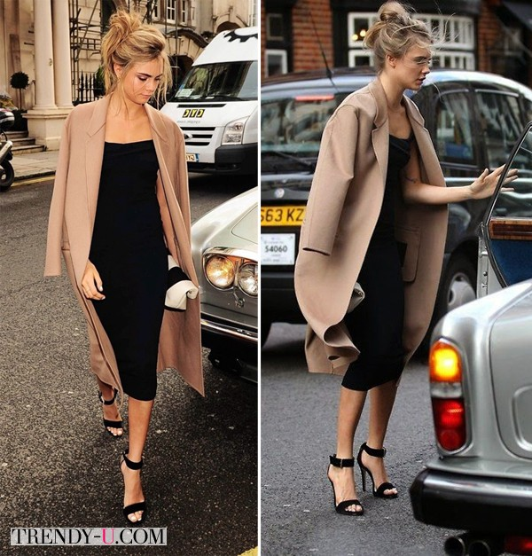 Кара Делевинь в черном платье и бежевом пальто