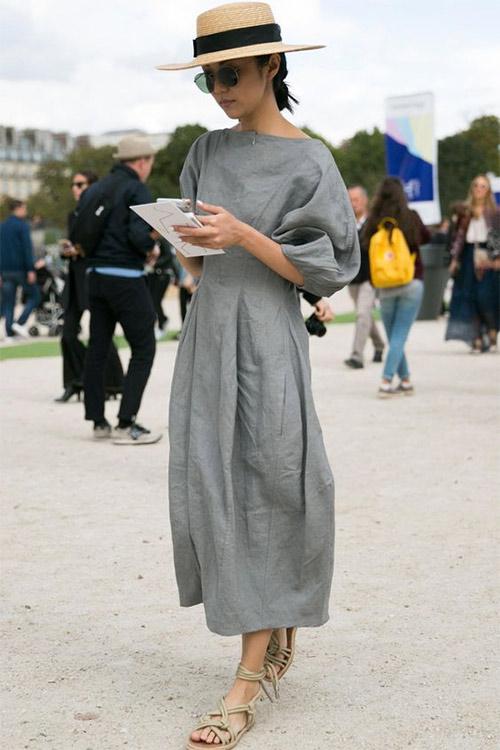 Модница в платье и шляпке