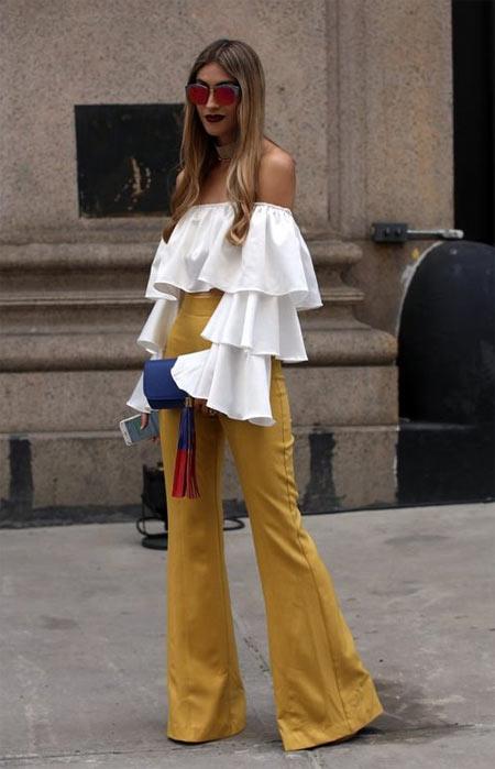 Белая блузка и желтые брюки для новогоднего образа 2018