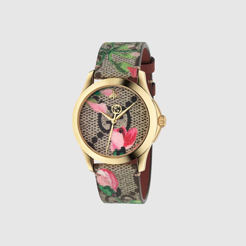 Женские часы с цветочным рисунком. Модель Gucci