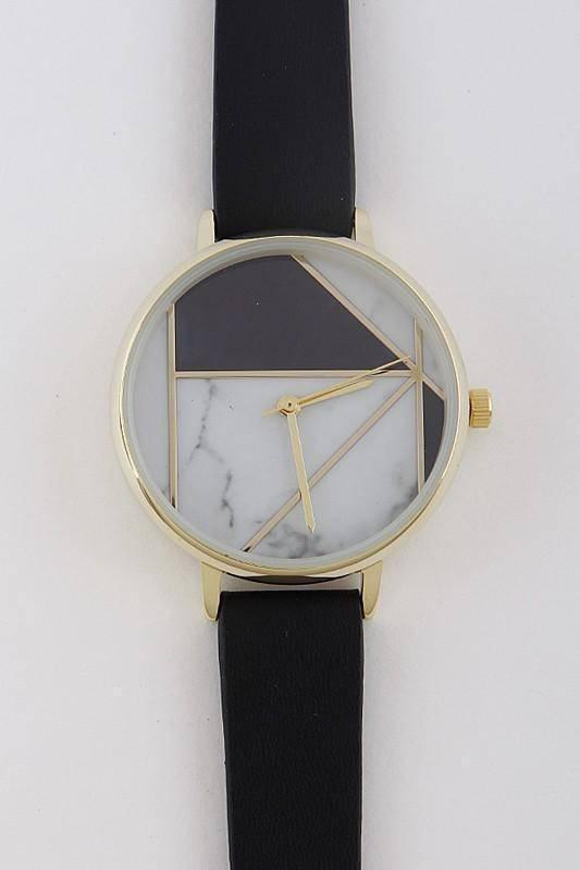Часы с геометрическим рисунком на циферблате